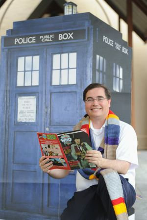 Father Paul Kelly with some of his Dr Who collection.