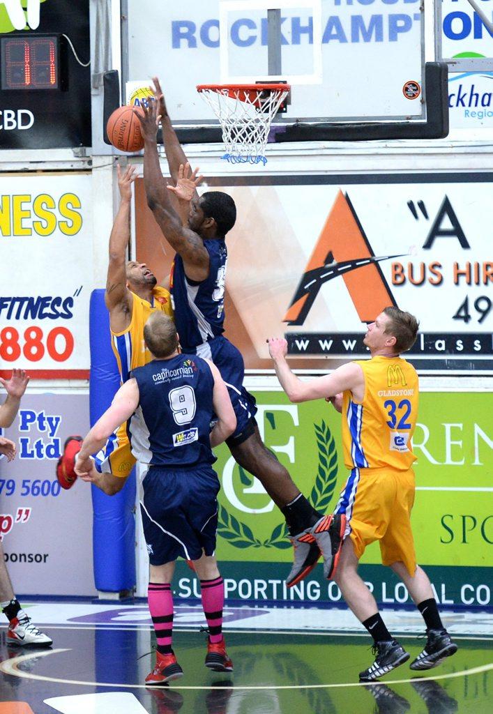 Rockets' Ray Turner blocks a Power player. Photo Allan Reinikka / The Morning Bulletin