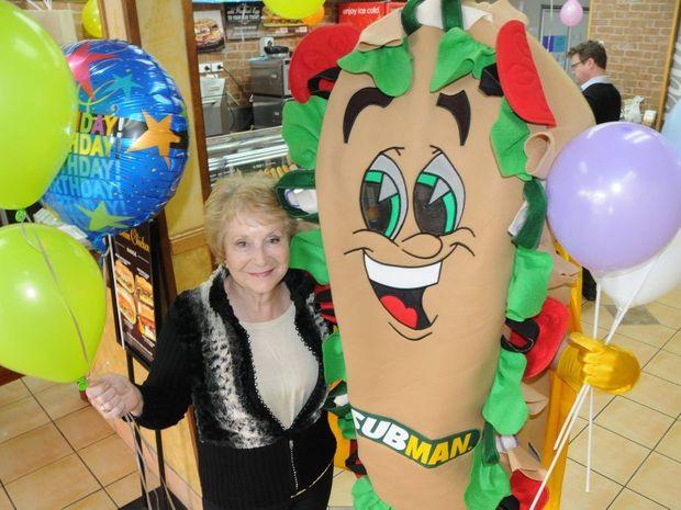 Subway Margaret St owner Hazel Johnstone with Subman.