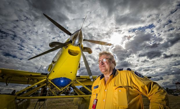 Aviation Support Officer with Rural Fire Service Graham Winters with the aircraft on standby at the Grafton Airport Photo Adam Hourigan / The Daily Examiner