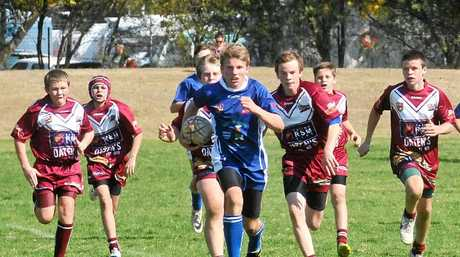 TOO GOOD: Grafton Ghost Caleb Barker leaves the Casino defence behind in the Group One Under-13 clash at McGuren Field. Photo: Bill North
