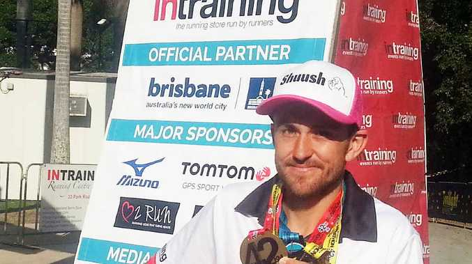 MEDAL GLORY: Brisbane Marathon winner Clay Dawson.