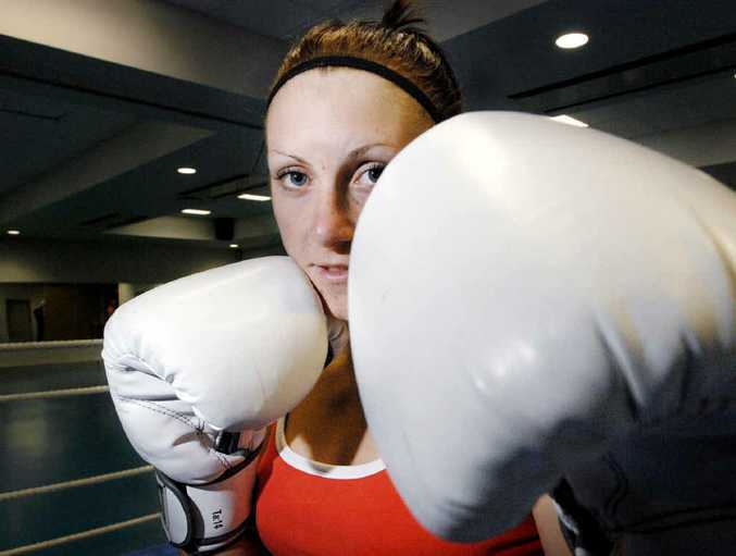 GOLDEN GIRL: Shelley Watts in Goonellabah in 2010 after she won her first fight by TKO.
