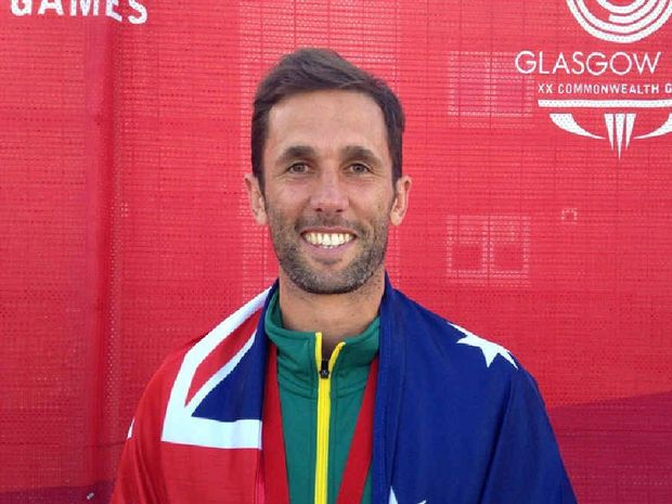 DOUBLE DELIGHT: Rockhampton's Mark Knowles was chosen as the Australian flagbearer for the closing ceremony of the Glasgow Commonwealth Games just hours after winning gold with the Kookaburras.