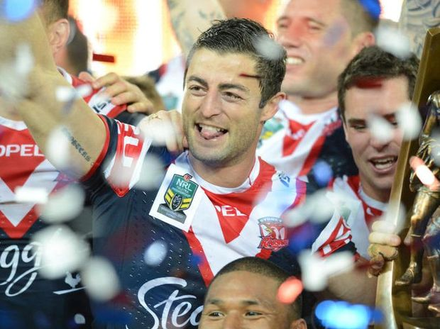 A Sunday, Oct. 6, 2013 file photo of The Roosters' captain Anthony Minichiello celebrates their win in the 2013 NRL Grand Final match between the Sydney Roosters and the Manly Sea Eagles at ANZ Stadium in Sydney. Minichiello has announced he will retire at the end of the 2014 NRL season.