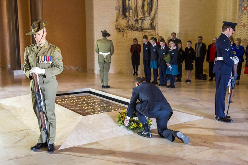 Australia's Prime Minister Tony Abbott (C) lays a wreath during a ceremony to mark the 100th anniversary of the start of WW1 at the Australian War Memorial in Canberra on August 4, 2014. Australia and New Zealand marked the 100th anniversary of the outbreak of World War I on August 4, with Prime Ministers Tony Abbott and John Key calling it a conflict that shaped their nations.