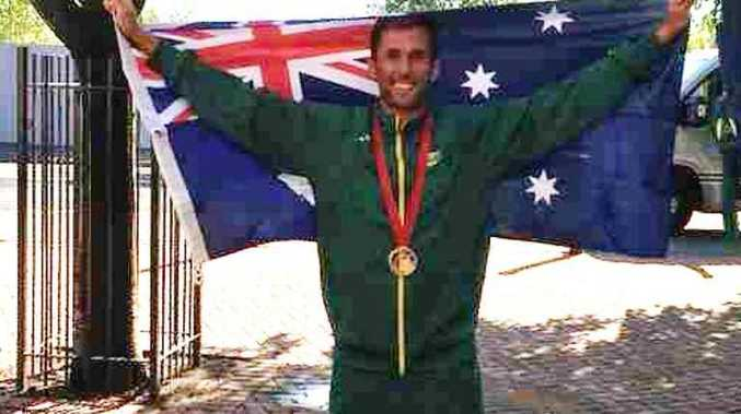 Photo of Mark Knowles with Australian Flag he carried at closing ceremony of the Glasgow Commonwealth Games, as posted on Twitter by Kookaburras.