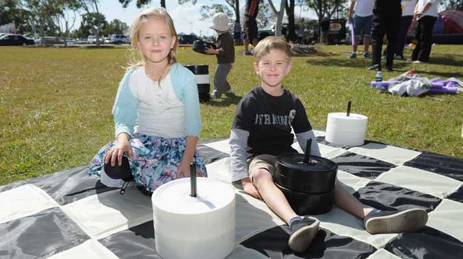 Alice, 7, and Benjamin Shield, 9, playing draughts at the USQ open day.