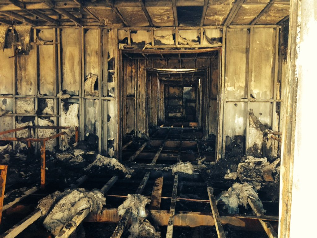 The aftermath of the fire that ripped through a Santos-leased workers camp.