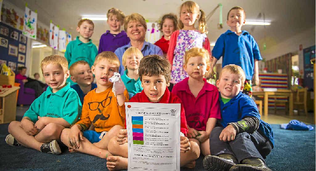PRIZED PAPER: Kookaburra Creek Kindergarten co-director Jennifer Jorgensen among her charges celebrating the national standard notification.