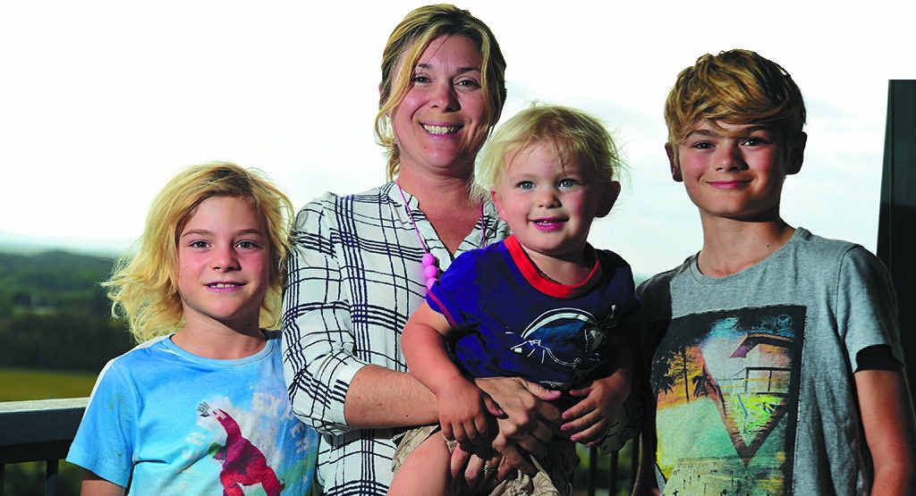 HANDS FULL: Meg Nagle with her three sons.