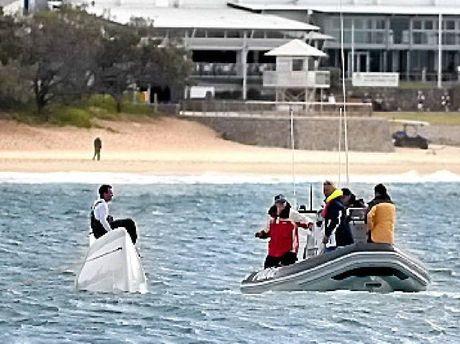 STUBBORN: The overturned catamaran.