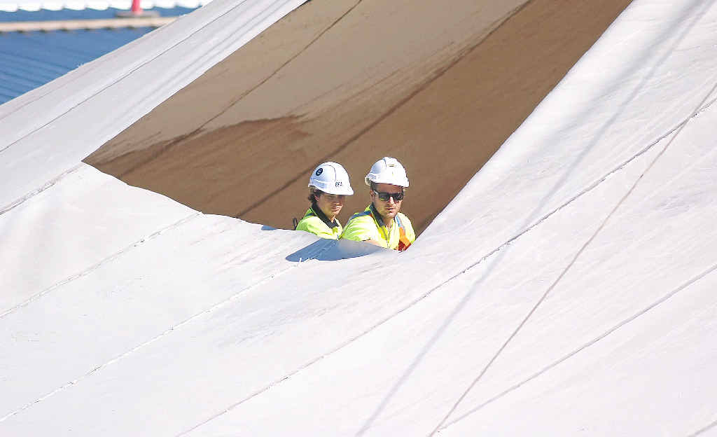 SAIL AWAY: Workers help take down the Big Top's iconic shade sails in preparation for the next stage of the redevelopment and, inset, the centre in the beginning in 1986.