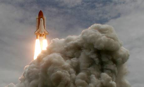 The Atlantis Space Shuttle launches - the brown tank is all for fuel.