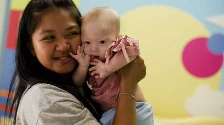 Thai surrogate mother Pattaramon Chanbua holds baby Gammy