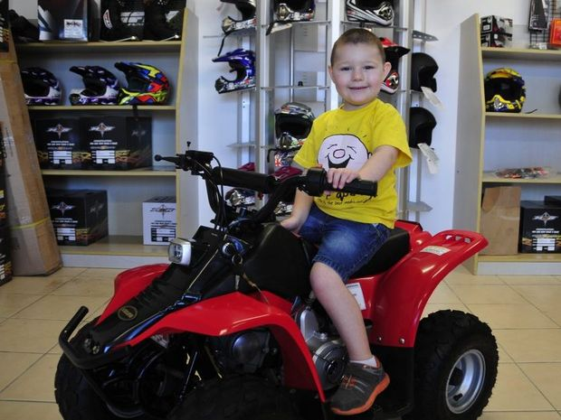 Ben Jessen, 4, whose quad bike was stolen on Monday, was ecstatic to be on the receiving end of immense generosity at the hands of the Gladstone community, and Jane and Richard Robinson at Mild to Wild Motorcycles.
