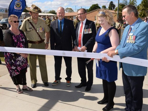HONOURING JACOB: Sandy Moerland, Lieutenant Colonel Matthew Richardson, Robert Moerland, Terry Meehan, Laura Moerland and Craig Fothergill open new RSL low cost housing facilities dedicated to hometown hero Sapper Jacob Moerland. Photo: Mike Knott / NewsMail