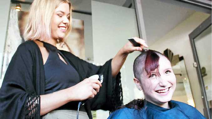 CLOSE SHAVE: Manik hairdresser Shell Whyatt shaves Callie Bale hair for cancer research.