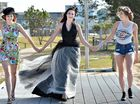 Laura Feitz (left), Shan`e Bartels and Brooke Finato model some of the fashion options women can choose for Mackay's Beach Horse Racing Festival Race Day on Saturday.