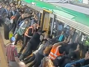 Perth commuters band together to push train off man