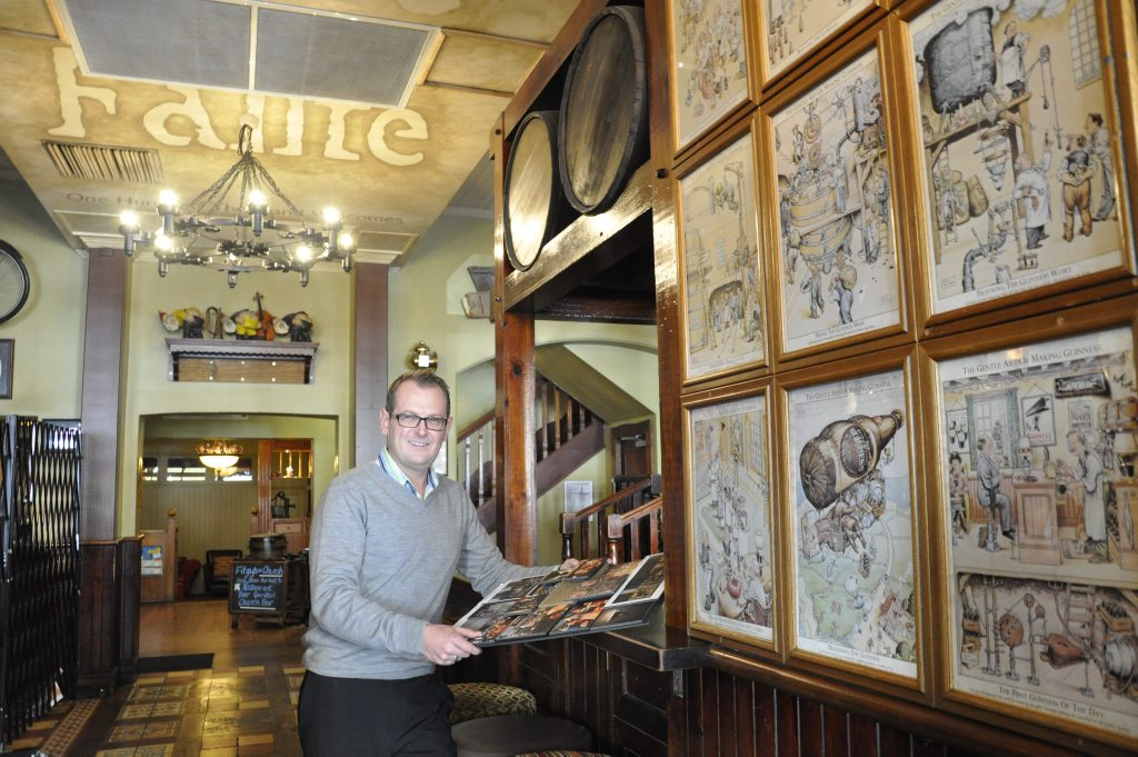 Fitzy's managing director Brad Fitzgibbons looks over plans to restyle the hotel's front Fibber Magee Irish bar.