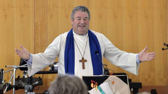 The Reverend Peter Arnett addresses the congregation.