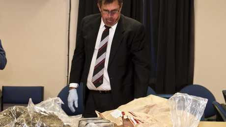 Detective Inspector Mick Dowie speaks to media about the drugs and cash found during raids at Warwick.