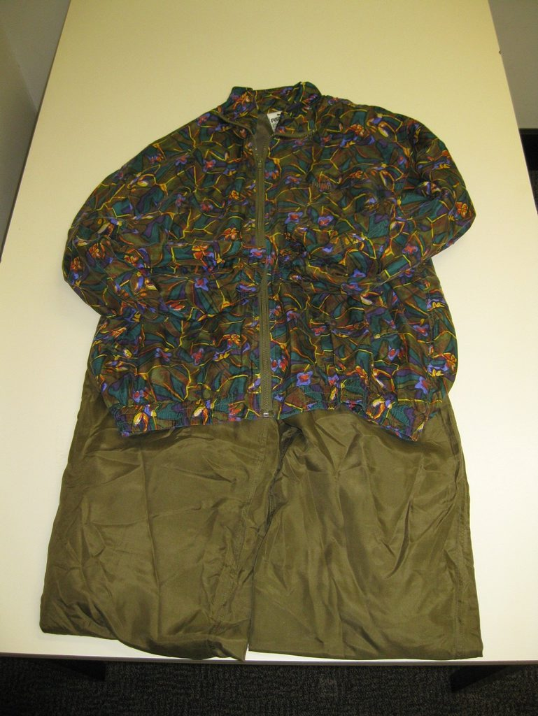 Coolangatta Police have released images of clothes left with a large sum of money at a charity store, with hopes of finding the rightful owner.