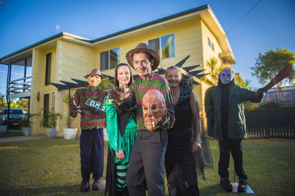 Ashlee Preston, David McDonnell and Annette McDonnell during the goodbye party for Annette and David McDonnell's haunted house on Illawara St, Gladstone.