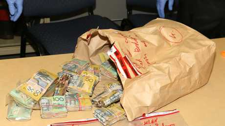Up to $300,000 in cash was found by police when they raided properties at Warwick.