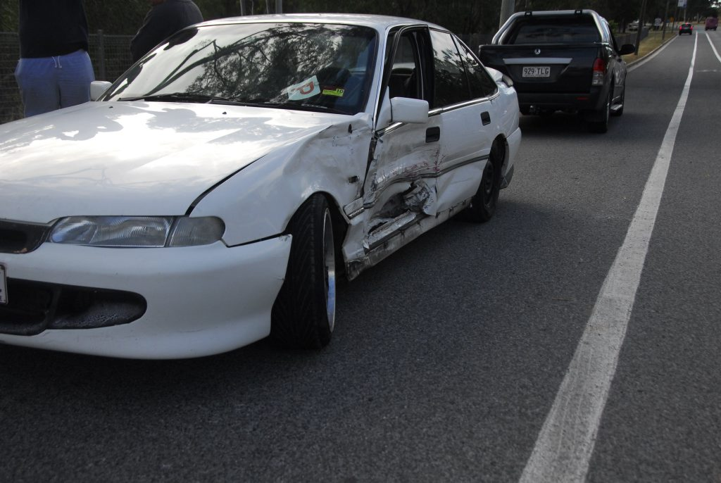 The white Holden Commodore that was damaged in the crash. Photo Andrew Backhouse / The Observer