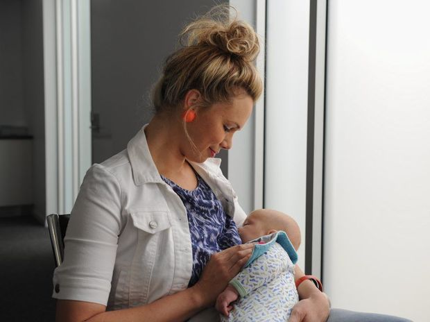 Mrs Sotik Sanderson with baby Isaiah. Mrs Sanderson has breast fed all of her children.