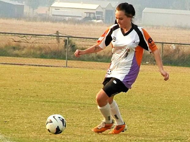 SIRENS IN SMOKE: Kayla Worthing in action for South Sirens in hazy conditions at Rushforth Park. PHOTO: CONTRIBUTED