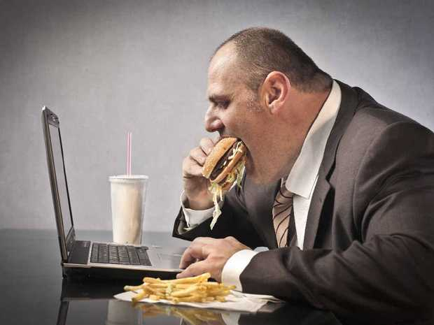 LUNCHTIME: Munching away at your desk? A prescription could put a stop to that, with research suggesting doctors should be able to limit the amount office workers sit down during the day.