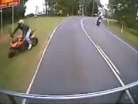 NEAR THING: Footage captured on a Clayton's Towing Service vehicle showed how close this motorcyclist came to hitting the truck on Maleny-Kenilworth Rd.