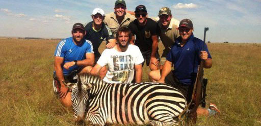 Crusaders rugby players, some of them All Blacks, are in the firing line after photos of Tom Taylor, Sam and George Whitelock, Tyler Bleyendaal and Ben Funnell were posted on a South African conservation organisation's Facebook page, showing them posing with dead animals