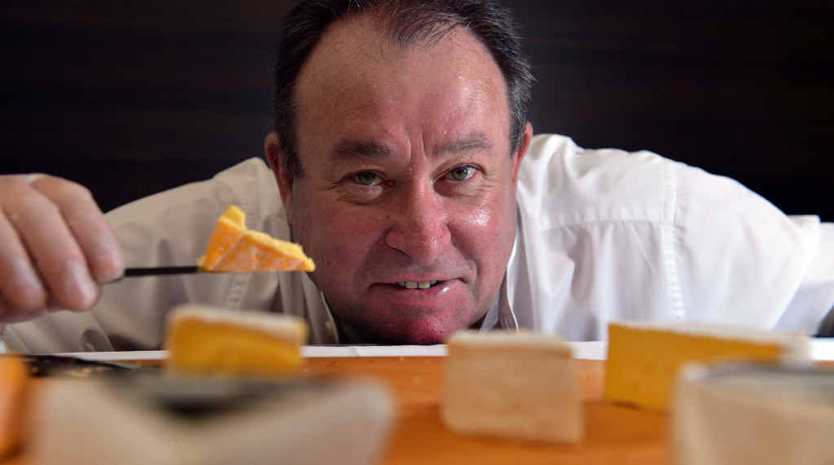 FOOD FOR THOUGHT: Woombye Cheese Company Director Graeme Paynter shows off his product at the Slow Food Australia National Meeting at Noosa Outrigger Resort.