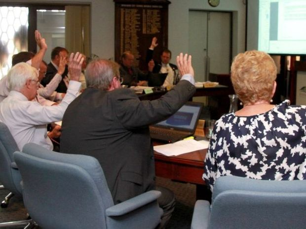 Raised hands at the Bundaberg Regional Council Meeting. Photo: Zach Hogg / NewsMail
