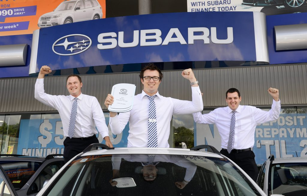 TOP EFFORT: Assistant sales manager Jonny Box, sales manager Sam Wolff and sales consultant Joshua Deane celebrate a recent Llewellyn Subaru award.