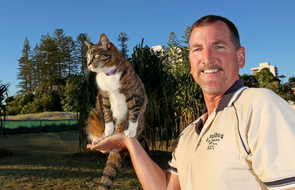 Animal behaviorist/ trainer Robert Dowllet with skate boarding cat Didga. Photo: Nolan Verheij-Full / Tweed Daily News