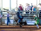 Roy Dunn rides Hot Rod in the final of the open bull ride at the Mt Isa Rodeo. Photo Contributed