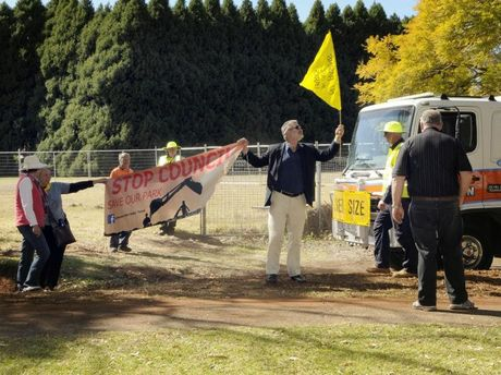 Protesters rally at Garnet Lehmann Park as council starts erecting temporary fences around the detention basin work site.