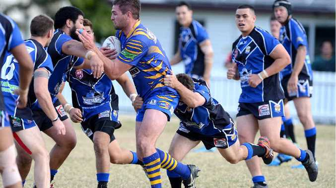 POWERHOUSE PERFORMANCE: Norths prop Tim Newton stands up to the Goodna defence during yesterday's IRL win at Goodna.