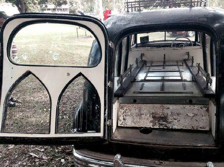 The vehicle has its original Gothic-type windows.
