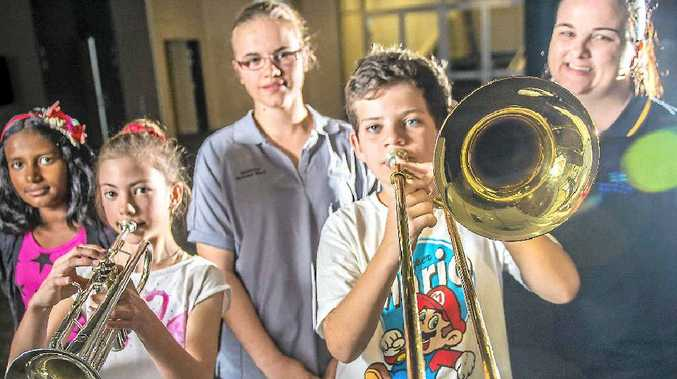 YOUNG ENERGY: Liyanna George 10, Charlotte Inglis 11, Lilanthi Wild 15, Nate Jacobs 10 and band conductor Leanne Christensen are a powerful new force.