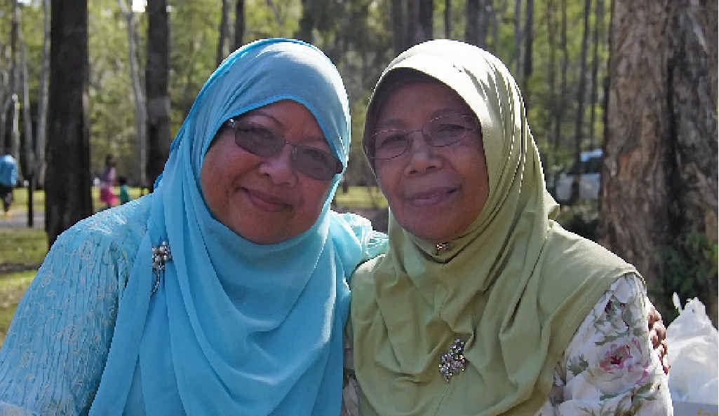 Rosita A. Rahman and Zainoon Tahir at the Eid gathering.