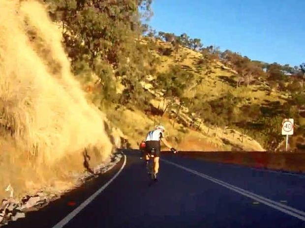 MIXED REACTIONS: Footage showing cyclists descending the Mt Morgan range. The rider with the camera passed several riders and at times crossed double white lines.