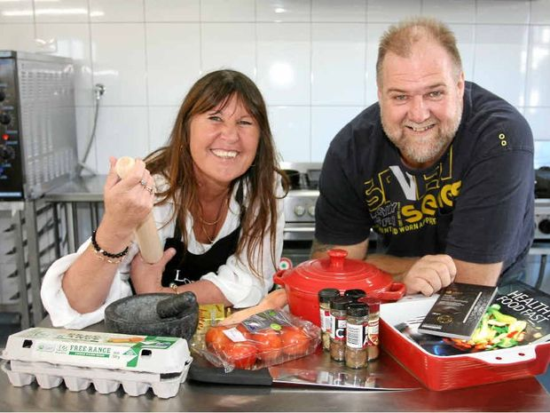 WINNING RECIPE: Maroochy Neighbourhood Centre staff Sharon Tambree and Mark Ellis are rapt to offer cooking classes in the revamped kitchen.