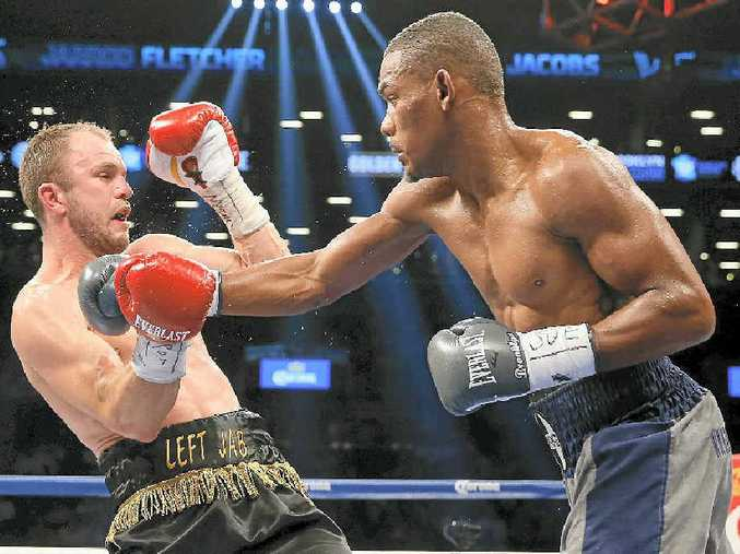 Daniel Jacobs (right) lands a right hand to the head of Jarrod Fletcher at the Barclays Center in New York.