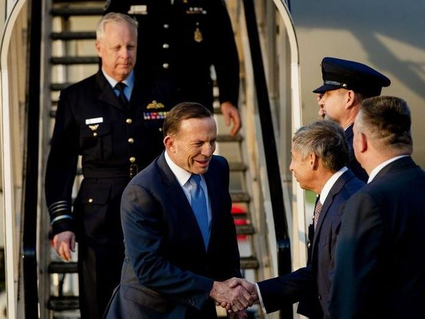 Australian Prime Minister Tony Abbott (C) is welcomed upon arrival at the Airport in Rotterdam, The Netherlands, 10 August 2014.